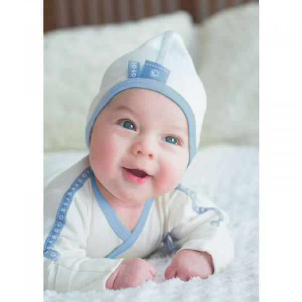 smiling baby with soft organic jersey bamboo Bonnet